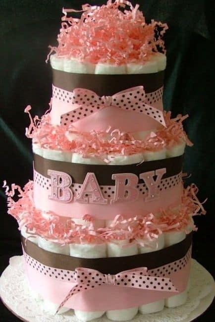 fotos de bolo de fraldas rosa e marrom diferente e barato