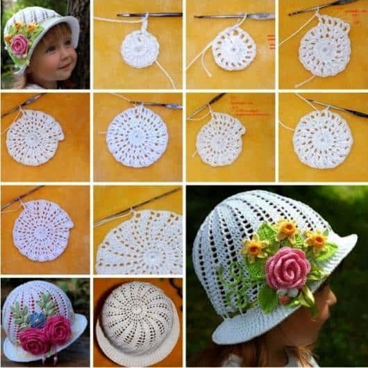 foto de menina com chapéu de crochê branco com rosas aplicadas com o gráfico do chapéu