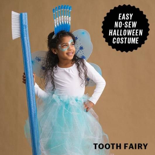 fantasia de fada do dente com varinha de escova de dente
