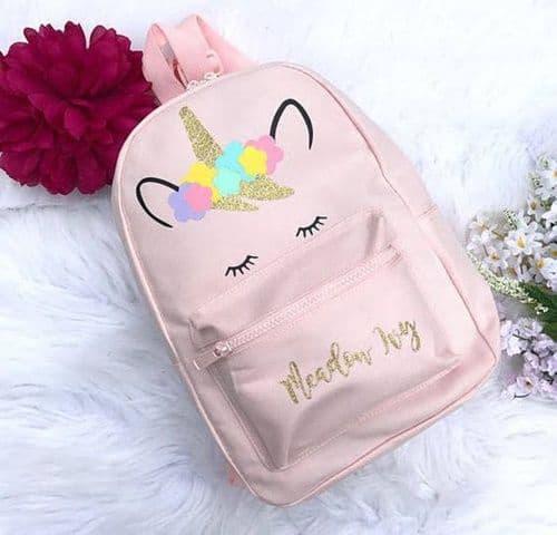 mochila rosa de unicórnio