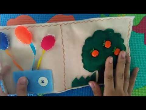 Livro infantil interativo com macieira