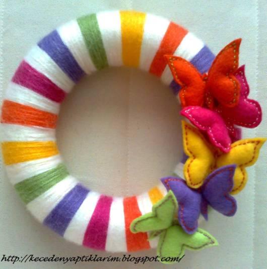 Guirlanda de feltro: borboleta colorida