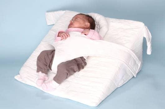 o travesseiro anti refluxo pode contar com proteção para o bebê não virar