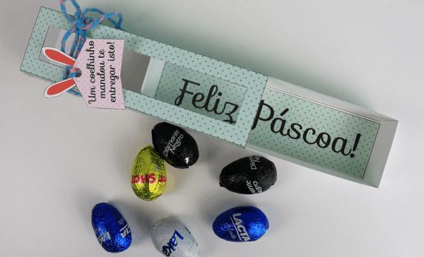 Caixa de papel com ovinhos e frase de feliz páscoa